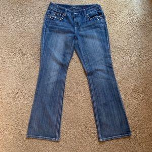 INC denim boot cut stretchy jeans.